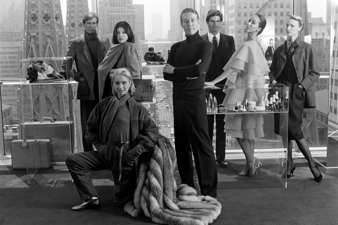 Designer Roy Halston surrounded by models in his licensed products and ready to wear 1982. Fairchild Archive Penske Media WWd - Office Tour: Halston